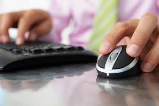Man using keyboard and mouse