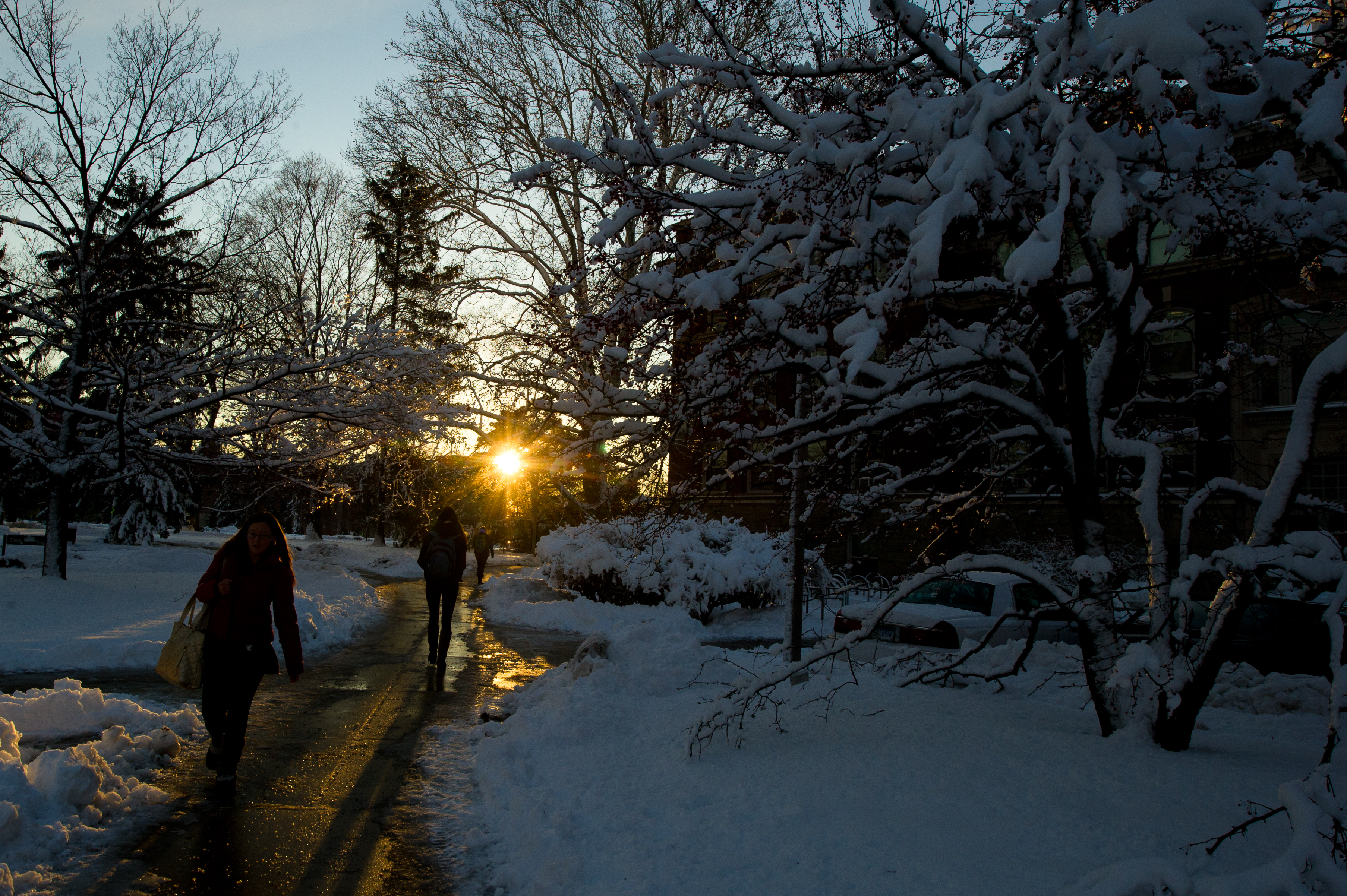 Students trekking through North Neighborhood over paths cleared by MSU IPF.