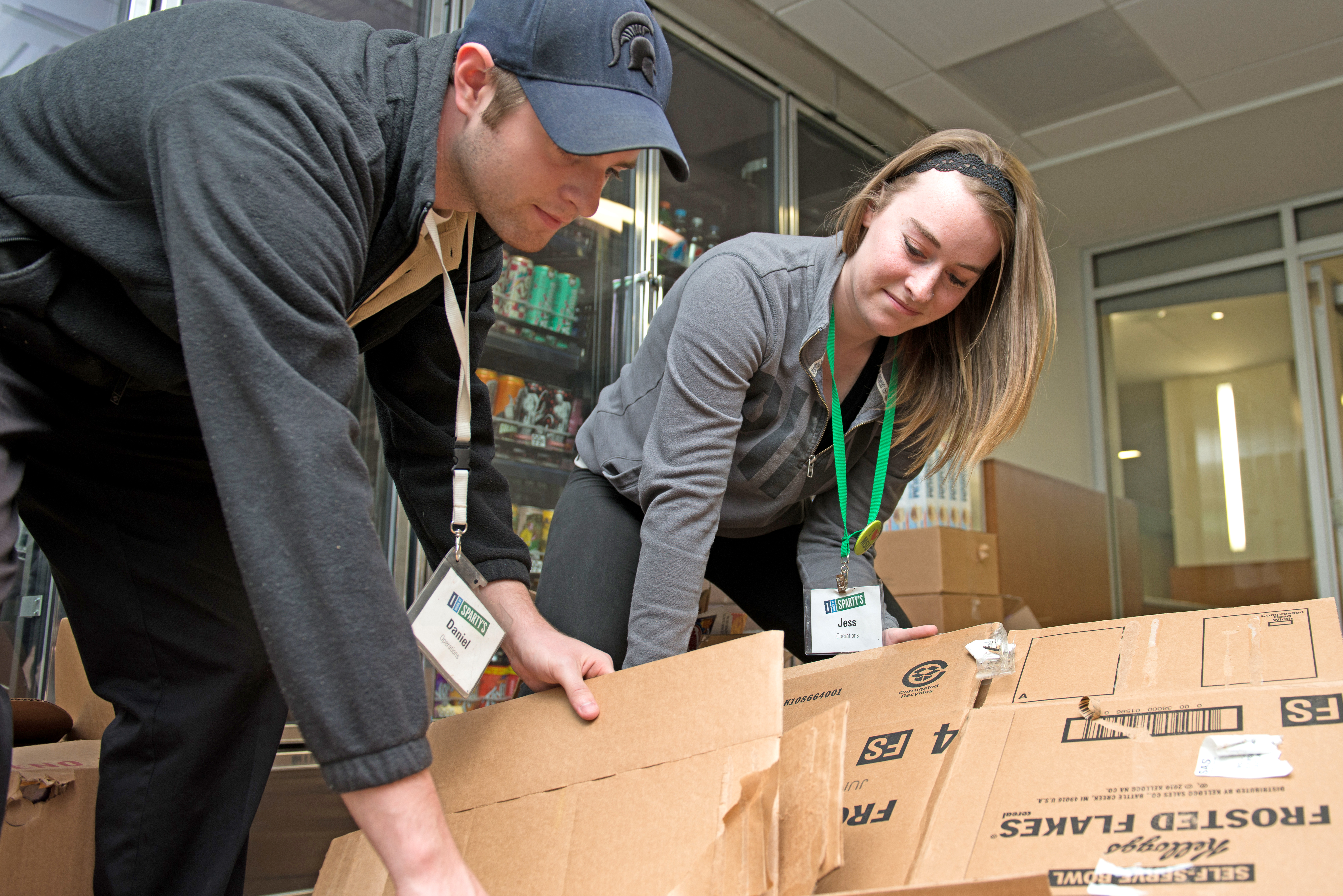 MSU Students employees in the MSU Union store prep boxes for the recycle bins.